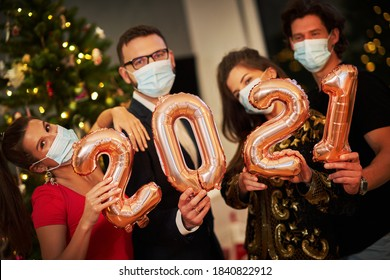 Two beautiful young couples having fun at New Year's Eve Party
