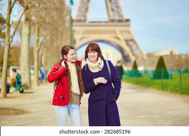 Two beautiful young girls in Paris near the Eiffel tower