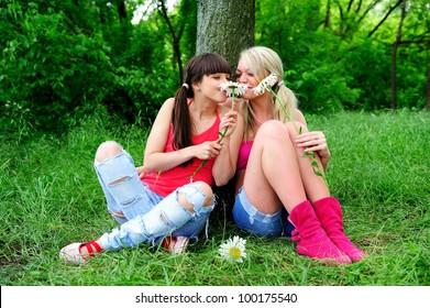 Two beautiful young women friends having fun outdoor.