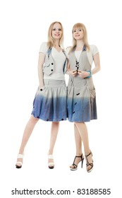 Two beautiful young women full length studio shot isolated over white background