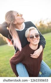Two beautiful young women having fun outdoors.