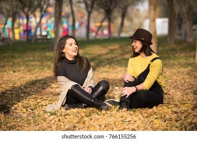 two beautiful young women having fun in the park
