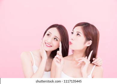 two beauty skincare woman look somewhere on the pink background