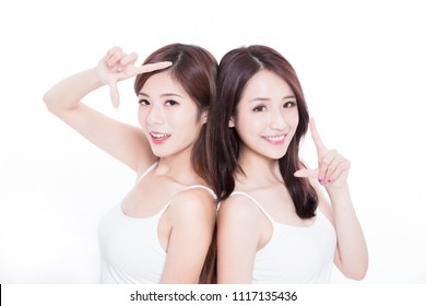two beauty skincare woman make frame gesture on the white background
