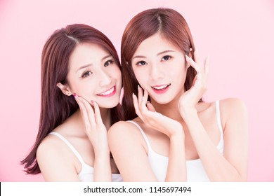 two beauty skincare women with health tooth on the pink background