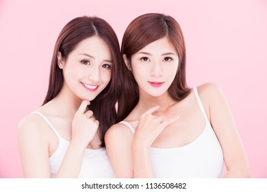 two beauty skincare women on the pink background