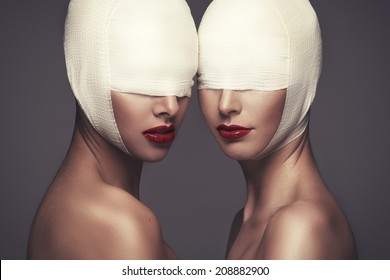 Two beauty woman with bandage