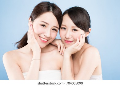 two beauty woman with healthy skin care on the blue background