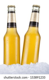 Two beer bottles sitting on ice over a white background.