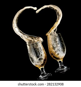 Two beer glasses up in a heart splash