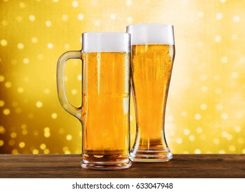 Two beer glasses on table.