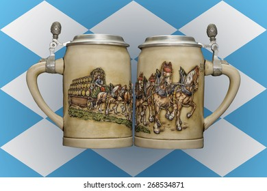 Two beer mugs on the background of the flag of Bavaria