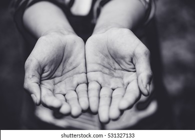 Two beggar hands palms up.Poor children Concept.Black and white.