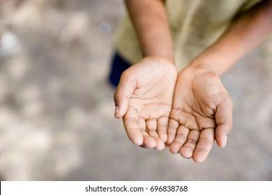 Two beggar hands palms up.Poor children and Poor people Concept.