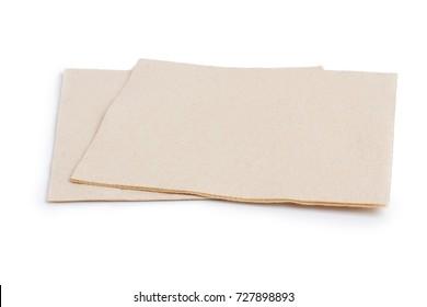 zwei beige Papierservietten
