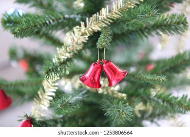two bell on christmas tree in horizontal image