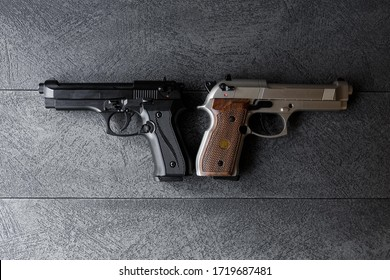 Two beretta on the black background