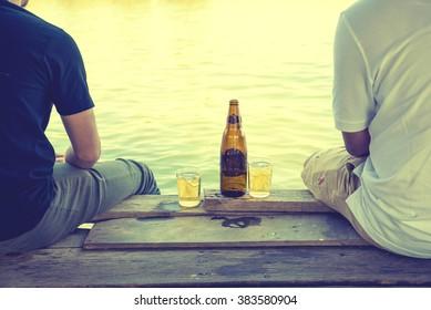 Two best friends drinking beer