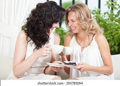 Two best friends having fun in cafe