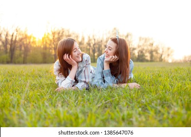 Two best friends lying on the grass