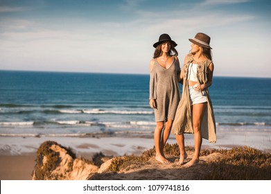 Two best friends near the coastline having fun on a beautiful summer day