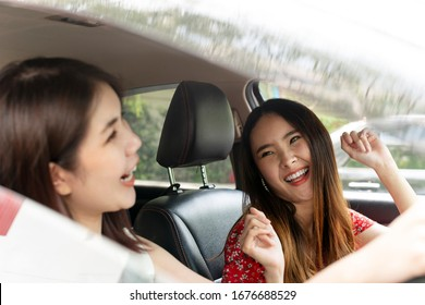 Two bestfriends travel together in a car. Road trip with close friend. Woman only.