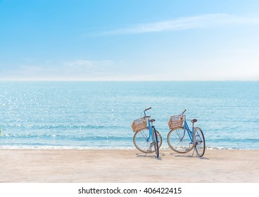 Two bicycle at the beach on blue sky
