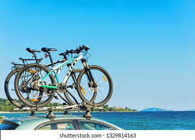 Two bicycle on the roof of the car by the beach.