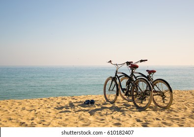 Two bicycles on the beach summertime fun in Barcelona, Spain