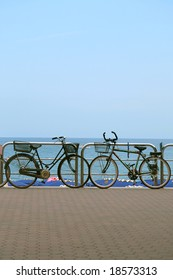 Two bicycles parked at the seaside promenade