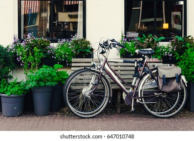 Two bicycles staying on a picturesque street in Amsterdam