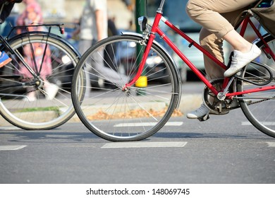 Two bicycles in traffic