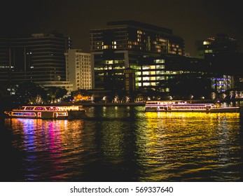 Two big boats are sailing on the river at night. Colorful at night.