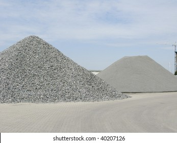 Two big piles of gravel at industrial site