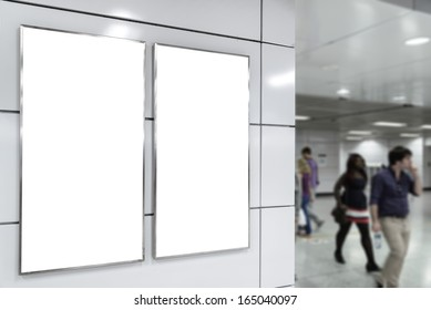 Two big vertical / portrait orientation blank billboard on modern white wall with blued passenger background