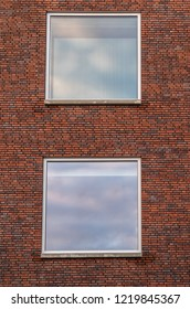 Two big windows with a Brick wall as architecture background.