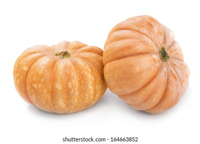 Two big yellow ripe pumpkin close-up on white background.