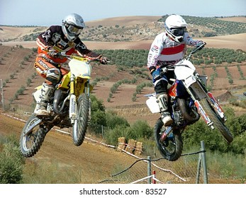 two bikers jumping