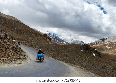 Two bikes among high snowy Himalayan mountains