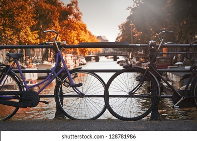 Two bikes on a bridge over a canal in Amsterdam (Netherlands)