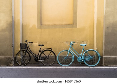 Two bikes at the wall