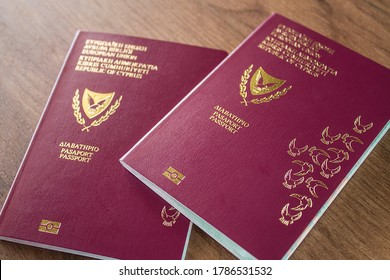 Two biometric Cypriot passports on a table.