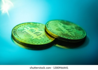 Two bitcoin coins isolated on technological blue background.