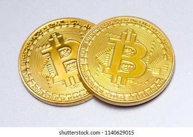 Two bitcoins. Digital currency used in internet as investment, payment and commerce