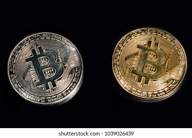 Two Bitcoins golden and silver coins on black background.  Virtual cryptocurrency concept. currency of the future