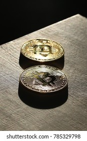 Two Bitcoins on a dark wooden background