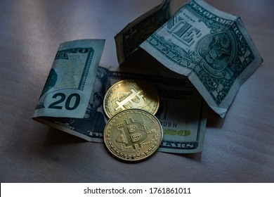 Two BitCoins on top of a 20 Dollar Bill (BTC-USD)