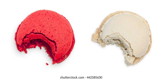 Two bitten macarons, berry and vanilla taste. Top view isolated object on white background.