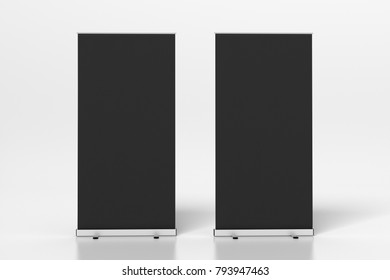 Two black blank roll up banner stands isolated on white. 3d illustration