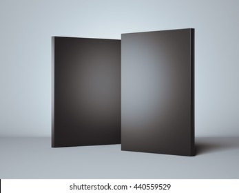 Two black boxes in bright studio. 3d rendering